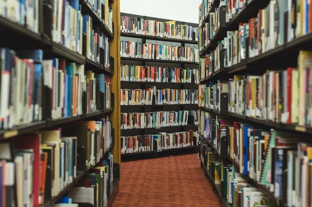 aisles of books in a library